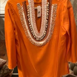 A silk blouse with the beads embroidery